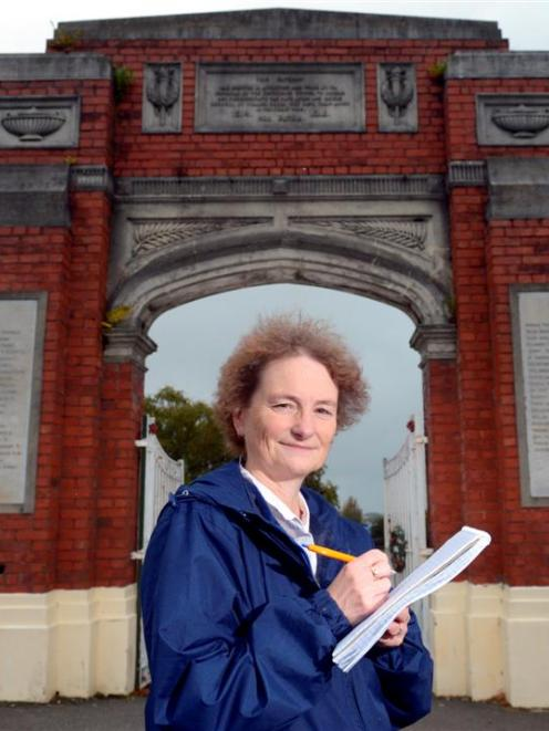Dunedin Family History Project convener Heather Bray records the details of the honour roll at...