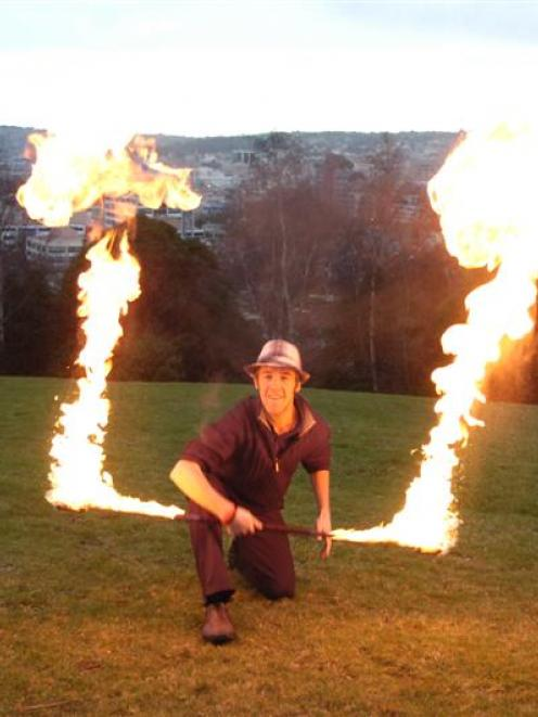 Dunedin fire performer Logan Elliott warms up yesterday for his big trip. Photo by Jane Dawber.
