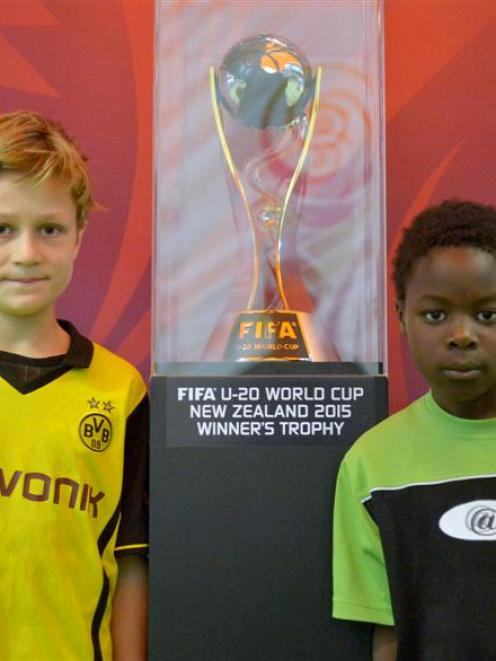 Dunedin football fans Finn Bielski-Cook (10, left) and Francis Potts (8) with the Fifa Under-20...