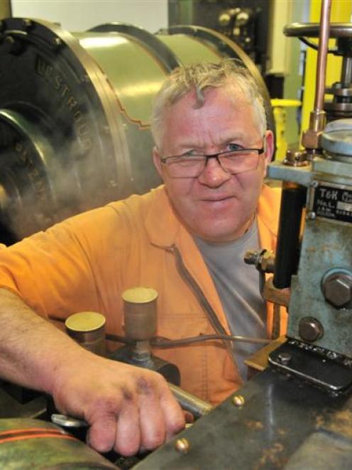 Dunedin Gasworks Museum engineering team co-ordinator Tom Galletly adjusts a steam-powered...
