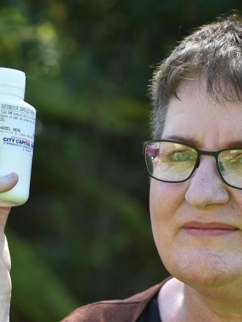 Dunedin law student Hazel Heal with drugs she sourced in Australia to cure her hepatitis C. Photo...