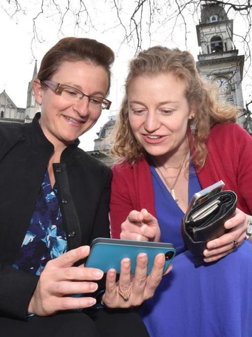 Dunedin lawyers Jackie St John (left) and Rachel Brooking test the Octagon's new gigabit Wi-Fi...