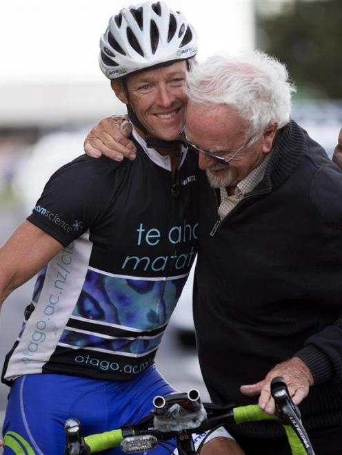 Dunedin man Andrew Nicholson, who had cycled around the globe in 123 days, is congratulated by...