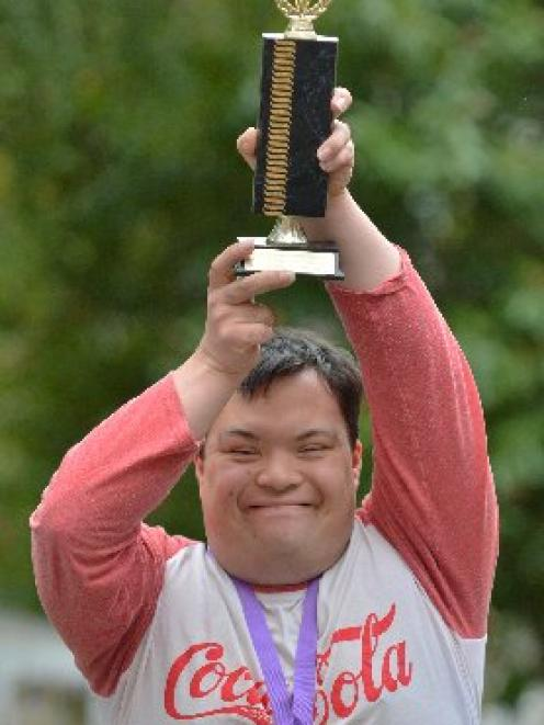 Dunedin man Christopher Tavite holds aloft the trophy he received in Wellington this week. Photo...