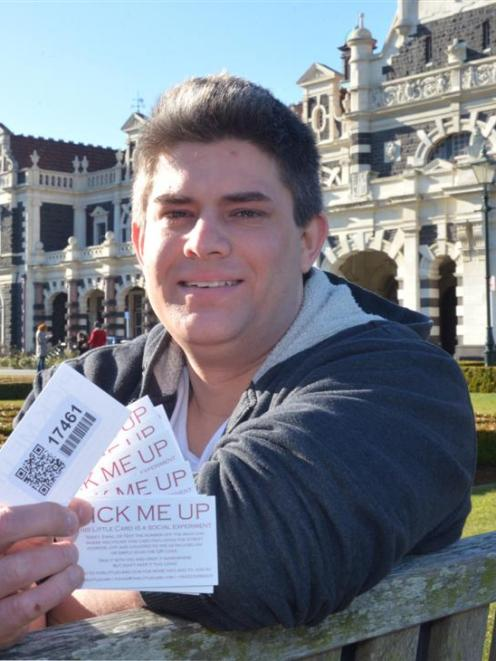 Dunedin man Dan Faulknor with his ''Little cards'', a social experiment where the card numbers...