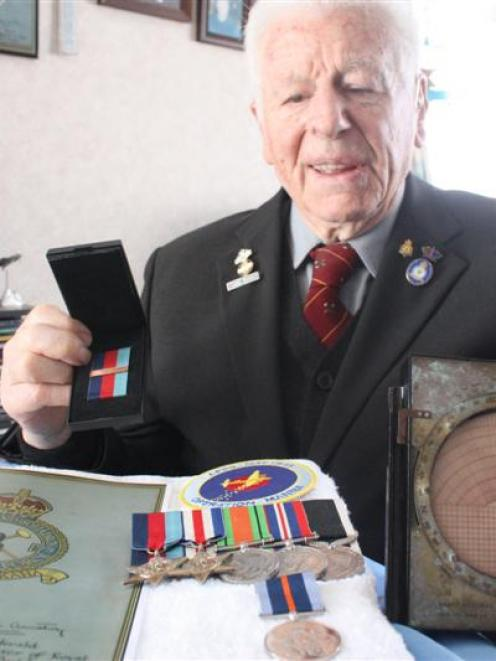 Dunedin man Neville Selwood can now add his Bomber Command clasp (in his right hand) to his other...