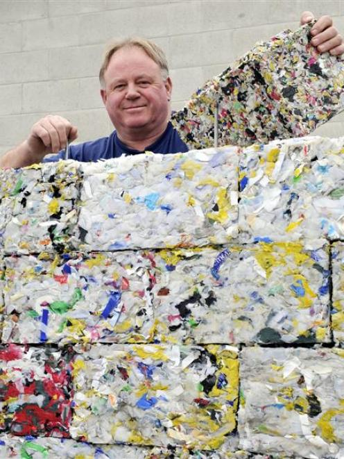 Dunedin man Peter Lewis shows off the bricks of recycled plastic made at the Green Island...