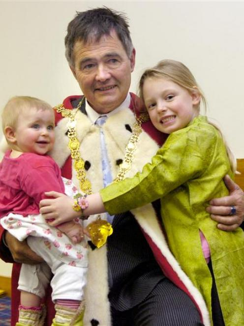 Dunedin Mayor Dave Cull is congratulated by granddaughters Carli (left) and Kaia Hutchison...