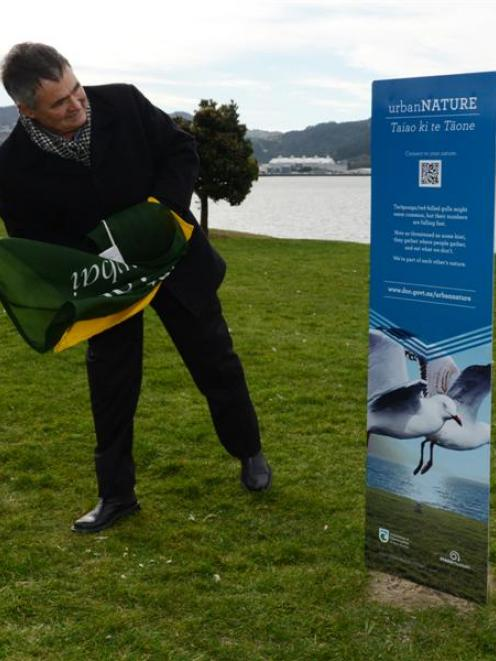 Dunedin Mayor Dave Cull unveils the first of a proposed 30 Urban Nature panels in Portsmouth Dr...