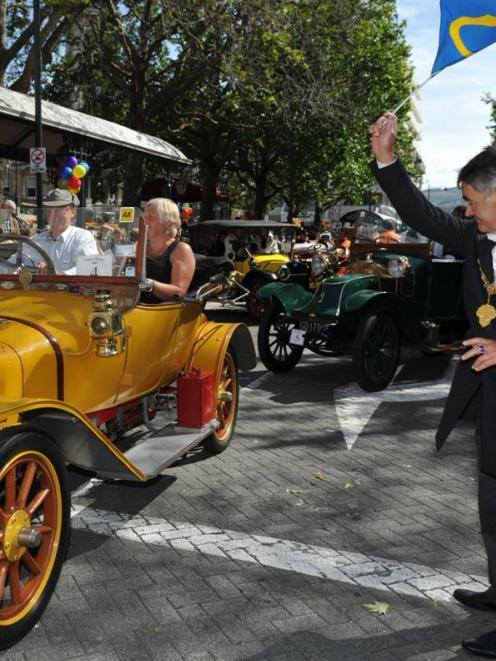 Dunedin Mayor Dave Cull waves off Chris and Pam Read in a 1914 Delage in the Octagon on Saturday....