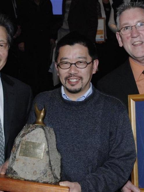 Dunedin Mayor Peter Chin (left) presents Dunedin Chinese Gardens Trust secretary-treasurer...