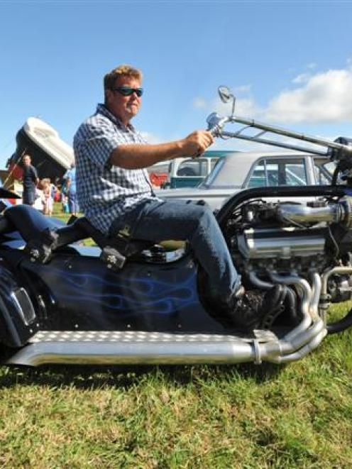 Dunedin mechanic Paul Barron on his custom-built V8 trike at Wings and Wheels at Taieri Airfield...