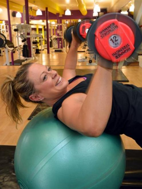 Dunedin mother Tash Columbus gets active at the the gym.  She spends about 14 hours a week...