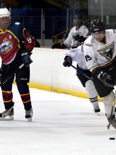Dunedin Penguins B player Larry Nichvolodov breaks away during yesterday's game against the Gore...
