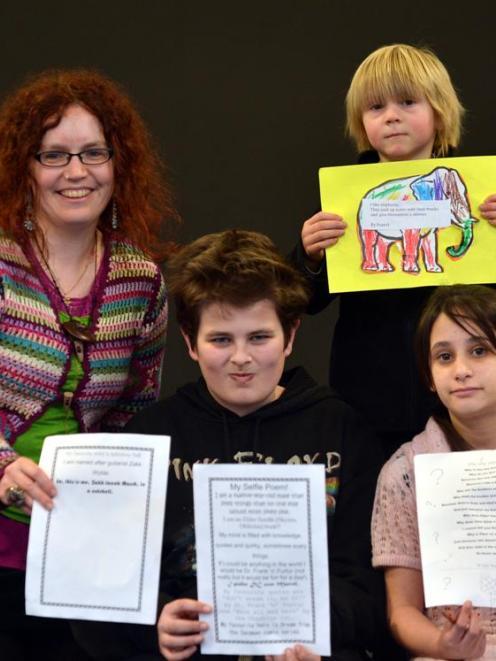 Dunedin poet Jocelind Dunford  helped Bathgate Park School  budding poets (from left) Zakk Marsh ...