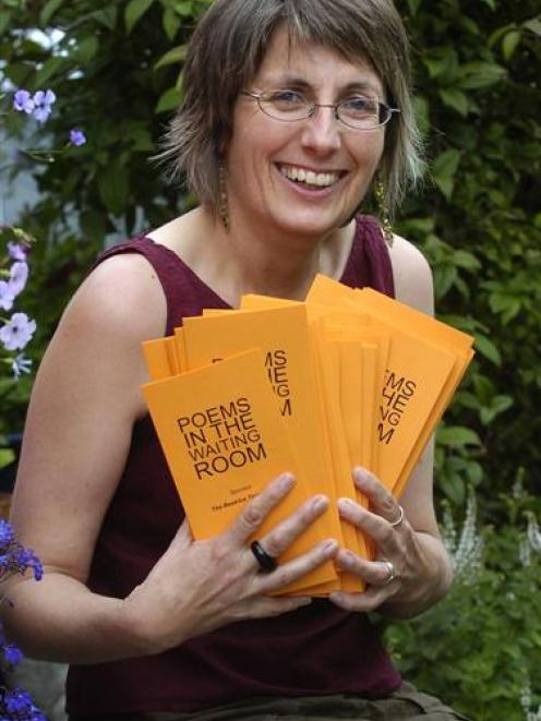 Dunedin poet Ruth Arnison with some of the poetry cards she is preparing to deliver to  waiting...