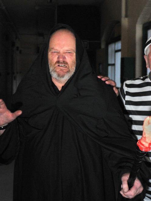 Dunedin Prison Charitable Trust volunteers Ken Burt (left) and John Thomson get into character...