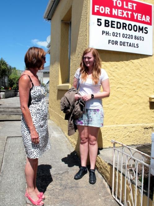 Dunedin property owner Gaynor Corkery shows third-year University of Otago student Jess Thomson...