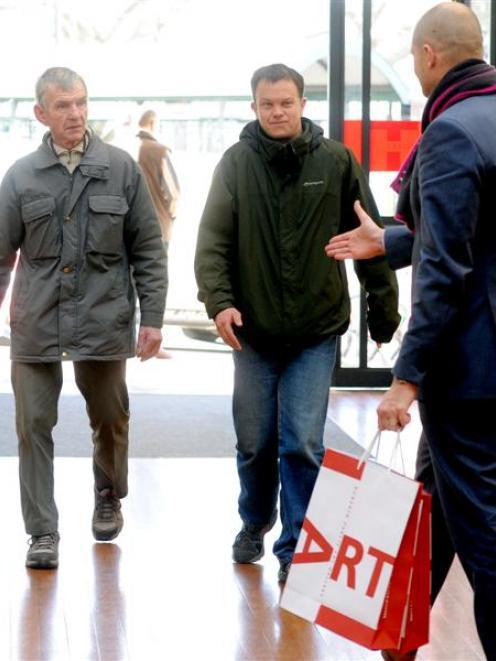 Dunedin Public Art Gallery director Cam McCracken (right) welcomes  Gordon McManus,  accompanied...