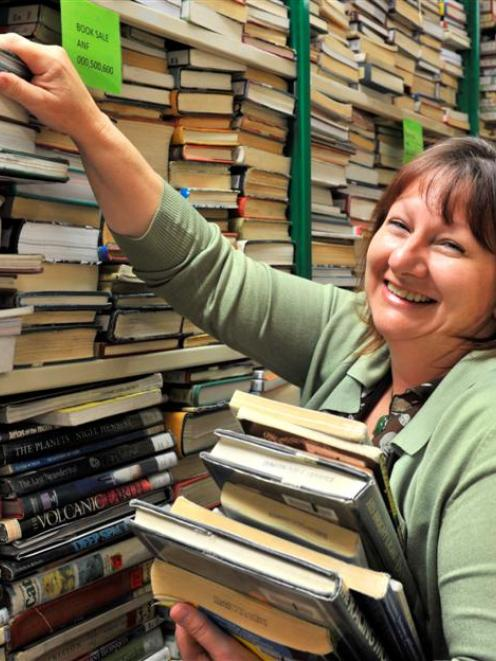 Dunedin Public Libraries marketing co-ordinator Kay Mercer holds stock set for the library's...