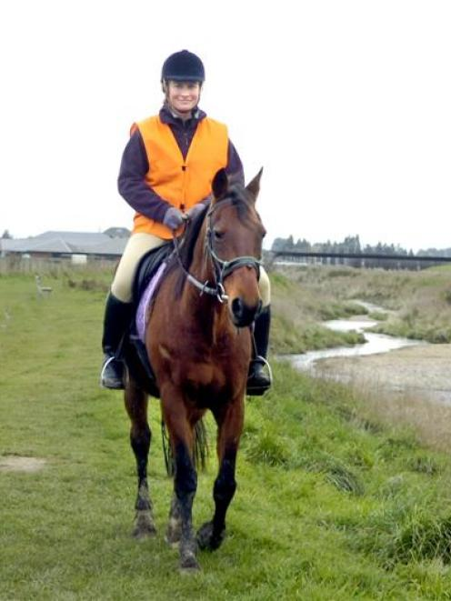 Dunedin Riding Centre owner Victoria Watt makes one last trip along the banks of the Silver...
