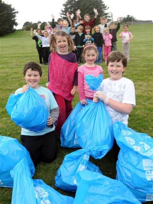 Dunedin's Rotary Park School pupils (front, from left) Nathan Farr (9), Ellie Jones (6), Ella...