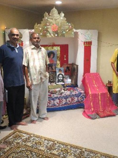 Dunedin's Sathya Sai Baba Hindu group members worship at household altars like this one as they...