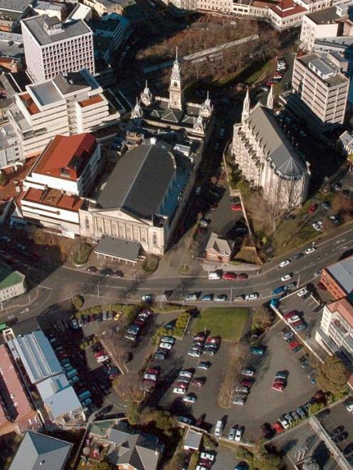 Dunedin's town hall (top), before its refurbishment.  The Moray Pl car park, talked of as a site...