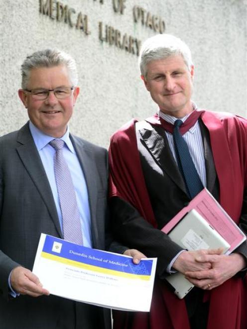 Dunedin School of Medicine top teaching award-winner Associate Prof Gerry Wilkins (left) and...