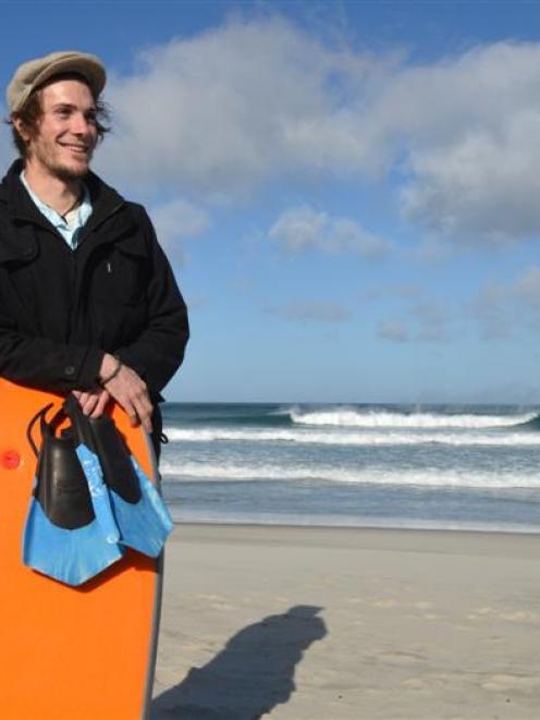 Dunedin surfer Brendan Ford back at Dunedin's St Kilda Beach, where he rescued a swimmer earlier...