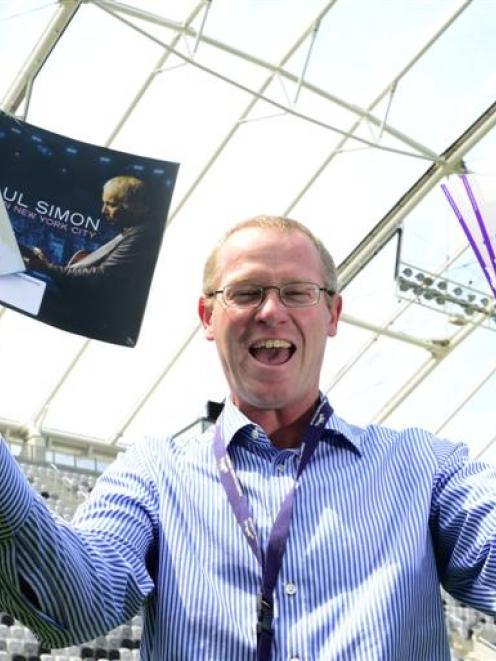 Dunedin Venues Management Ltd chief executive Darren Burden celebrates news  of the concert....