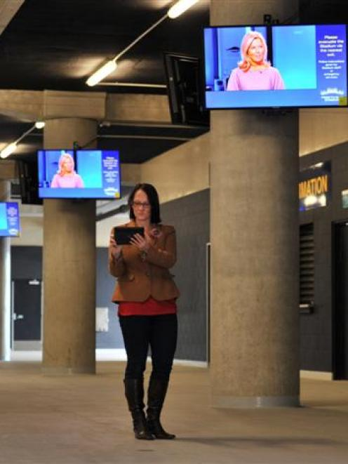 Dunedin Venues Management Ltd communications and media manager Jo Scully uses a portable tablet...