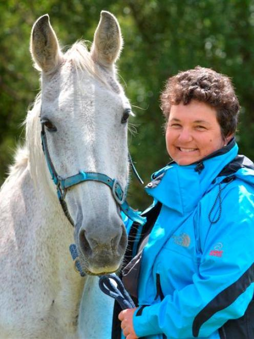 Dunedin woman Ulli Graham and horse Lucy, in Abbotsford yesterday, took a tumble on Abbots Hill...