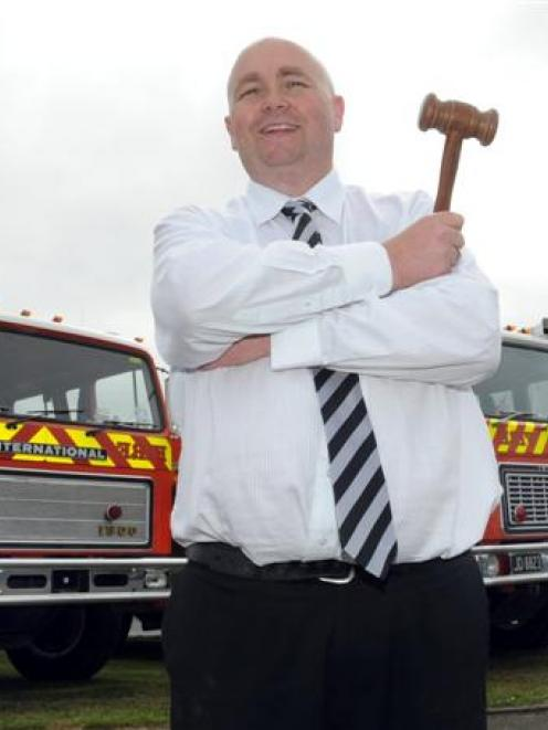 Dwayne Johnston is keen to drop the hammer on three fire engines,  for sale at Turners Auctions...