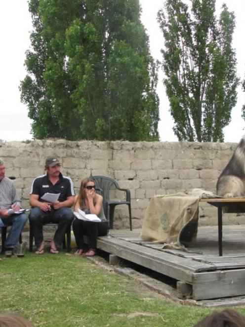 Dylan Boulton (11, of Ranfurly) tries to get his malamute Finn to bark for judges Tony Woodcock,...