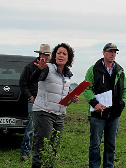 Ealing dairy farmer Devon Slee talks about native plantings on the property. At right is Andrew...
