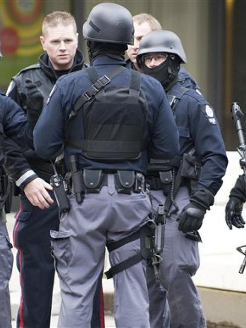 Edmonton Tactical personnel gather near the Workers Compensation Board building in Edmonton,...