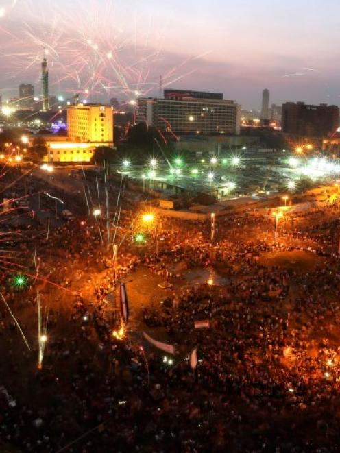 Egyptians celebrate after the swearing-in ceremony of President Abdel Fattah al-Sisi in Tahrir...