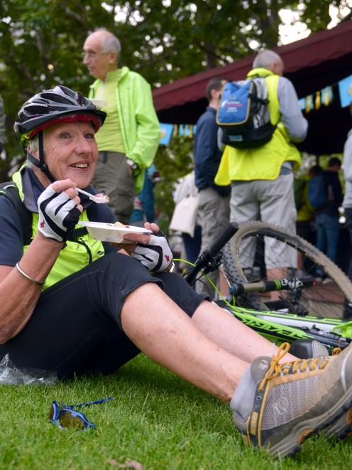 Elaine McDowell, of Dunedin, enjoys a free breakfast in the Octagon yesterday as part of Go By...