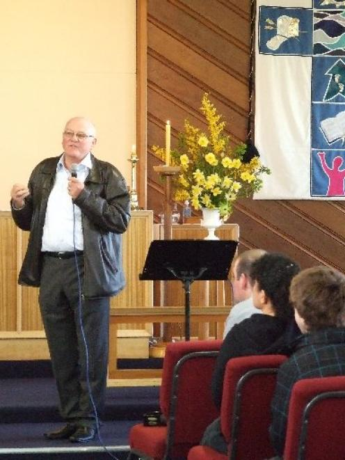 Elwyn Bates, who joined St Mark's parish in 1964, gives a speech during the church building's...