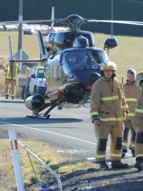 Emergency services at the crash scene. Photo Craig Baxter