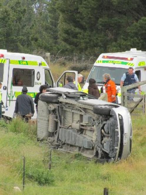 Emergency services attend Saturday's crash at Tarras. Photo by Sarah Marquet