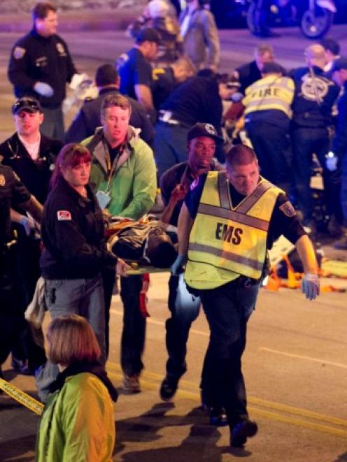 Emergency services personnel stretcher a person who was struck by the car. REUTERS/Jay Janner...
