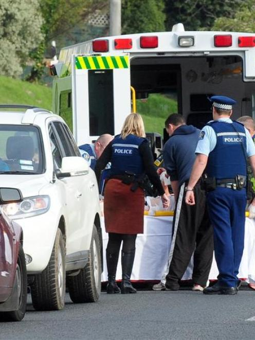 Emergency services treat a woman after a violent domestic incident in South Rd, Dunedin, last...