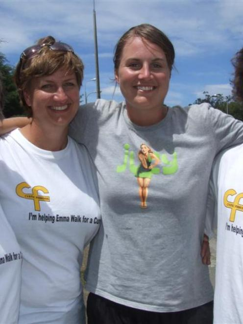 Emma Daken (second from right), who is walking the length of New Zealand, and supporters (from...