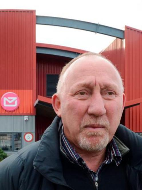 Engineering, Printing and Manufacturing Union organiser Mike Kirwood in front of the Dunedin mail...