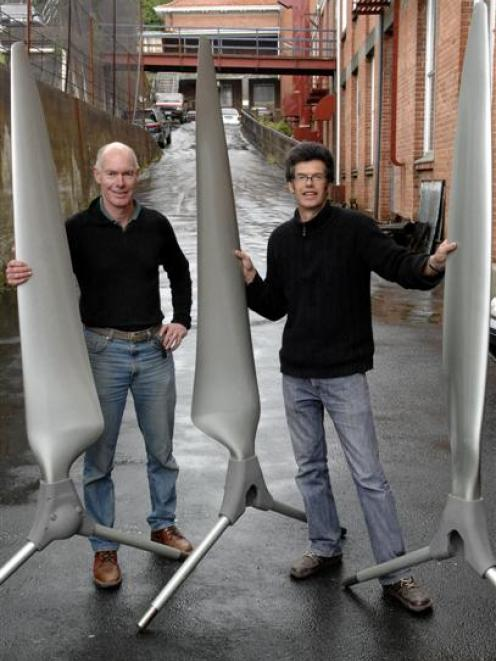 Engineers Bill Currie and Wayne O'Hara aim to have three of their unusual one-bladed wind...