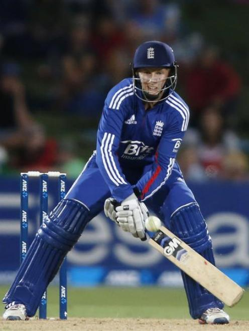 England batsman Joe Root plays a reverse scoop shot against New Zealand during the second one-day...