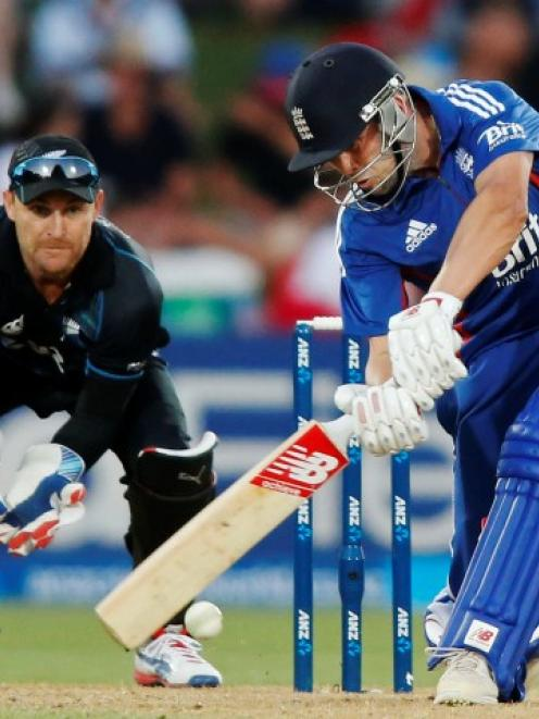 England batsman Jonathan Trott plays a shot watched by New Zealand wicketkeeper Brendon McCullum...