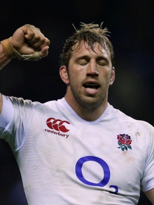 England captain Chris Robshaw celebrates defeating France in their Six Nations rugby match at...
